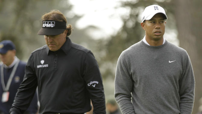 Tiger Woods and Phil Mickelson walk off the 12th tee during the first round of the U.S. Open Championship golf tournament Thursday, June 14, 2012, at The Olympic Club in San Francisco. (AP Photo/Charlie Riedel)