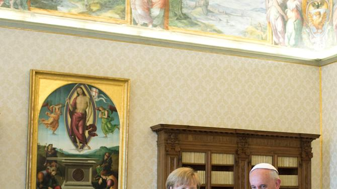 In this photo provided by the Vatican newspaper l'Osservatore Romano, Pope Francis meets with German Chancellor Angela Merkel during a private audience at the Vatican, Saturday, May 18, 2013. (AP Photo/L'Osservatore Romano, ho)