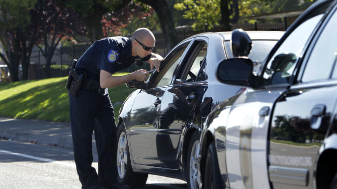 In this Nov. 12, 2012, photo, Sacramento Police Officer Matthew McPhail makes a traffic stop in Sacramento Calif.  Sacramento voters, who don't want to see a reduction in service such as public safety, approved a sales tax hike by a 2-to-1 ratio. During last week's elections, voters across the country opted to raise taxes to help their cities, counties and school districts. (AP Photo/Rich Pedroncelli)