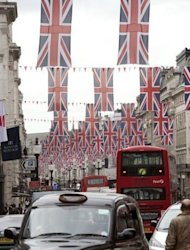 Britain&#39;s Union flags line a street in London on June 1. Britons have begun four days of festivities for Queen Elizabeth II&#39;s diamond jubilee, turning out in droves for events around the country in a surge of enthusiasm for the monarchy