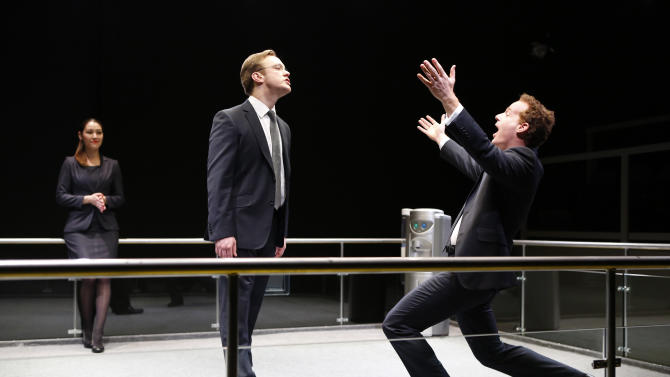 """This theater image released by 59E59 Theaters shows, from left, Eleanor Matsuura, Sam Troughton and Adam James, in a scene from Mike Bartlett's new comedy, """"Bull: The Bullfight Play,"""" currently performing as part of Brits Off Broadway at 59E59 Theaters in New York.  (AP Photo/59E59 Theaters, Carol Rosegg)"""