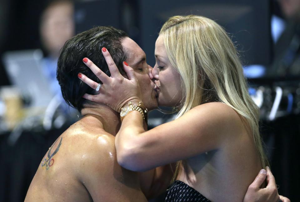 Eric Shanteau kisses his wife Jeri Moss Shanteau after placing in the second in the men's 100-meter breaststroke final at the U.S. Olympic swimming trials, Tuesday, June 26, 2012, in Omaha, Neb. Brendan Hansen won the final. (AP Photo/David J. Phillip)