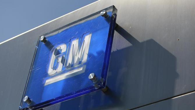The General Motors logo is seen outside its headquarters at the Renaissance Center in Detroit