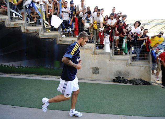 CARSON, CA - JULY 19: David Beckham #23 of the Los Angeles Galaxy runs out to the pitch as fans cheer him on before the MLS game against AC Milan at The Home Depot Center on July 19, 2009 in Carson, C