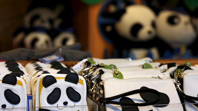 Wallets in the shape of a panda are displayed inside a souvenir store at the Hong Kong Ocean Park