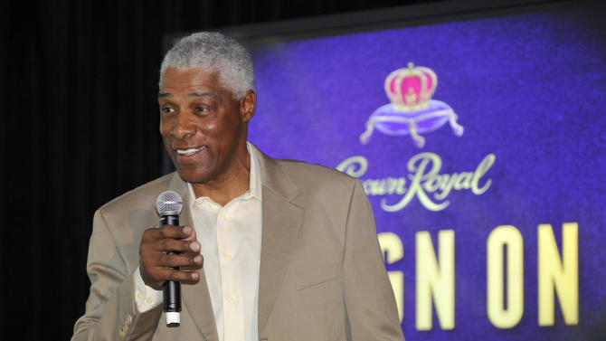 IMAGE DISTRIBUTED FOR CROWN ROYAL - Basketball legend Dr. J shares his Reign On moment at the Crown Royal Reign On launch party during All-Star weekend on Saturday, Feb. 16, 2013, in Houston. Reign On is Crown Royal's new advertising campaign released this week. (Photo by Jack Dempsey/Invision for Crown Royal/AP Images)