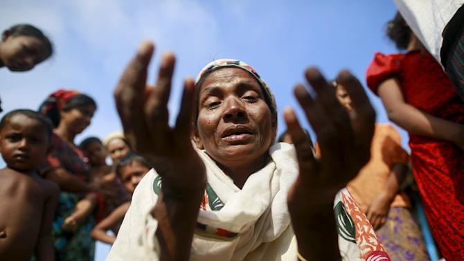 Zarli Hartu, 46, cries for her son Marmot Ismai, who she says was kidnapped into a human trafficking camp, at a refugee camp outside Sittwe