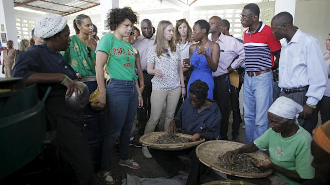 Clinton Foundation Vice Chair Chelsea Clinton listens to Yve-Car Momperousse, founder of Kreyol Essence, during a visit to the production facilities of the CETPA in Mirebalais