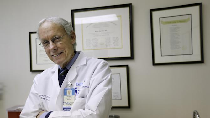 In this Jan. 10, 2013 photo, Dr. Richard Dupee leans against a counter in his Wellesley, Mass., office. Dupee, a primary care physician and solo practitioner with a subspecialty in geriatrics, said the 2006 Massachusetts health care law had plusses and minuses. (AP Photo/Steven Senne)