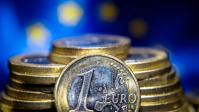 The EU upgraded its growth outlook for the eurozone Tuesday on the back of cheaper oil and a weak currency, but a sudden worsening of Greece's economic woes cast a pall over the brightening situation