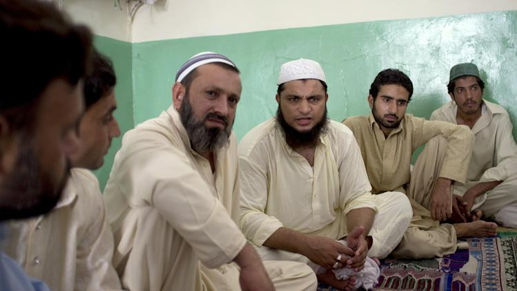 Cleric Hafiz Mohammad Zubair, third from right, meets with residents in a suburb of Islamabad, Pakistan at a local mosque on Monday, Aug. 20, 2012 regarding an alleged blasphemy by a Christian girl. Pakistani authorities arrested a Christian girl and are investigating whether she violated the country's strict blasphemy laws after furious neighbors surrounded her house and demanded police take action, a police officer said Monday. The arrest of the girl and outrage among the local community demonstrates the deep emotion that suspected blasphemy cases can evoke in this conservative Muslim country, where rising extremism often means religious minorities live in fear of persecution. (AP Photo/B.K. Bangash)