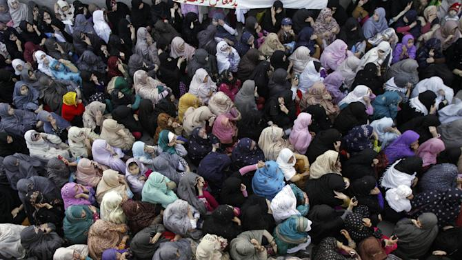 Pakistani Shiite Muslim women attend a protest to condemn Saturday's bombing in Quetta, Pakistan, Sunday, Feb. 17, 2013. Angry residents on Sunday demanded government protection from an onslaught of attacks against Shiite Muslims, a day after scores of people were killed in a massive bombing that a local official said was a sign that security agencies were too scared to do their jobs. (AP Photo/Arshad Butt)