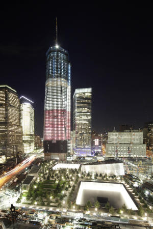 One World Trade Center and the September 11 Memorial are ablaze in lights Friday, Sept. 9, 2011 in New York. Sunday will mark the 10th anniversary of the September 11 attacks on the United States. (AP Photo/Mark Lennihan)