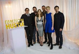 """""""American Hustle"""" director Russell poses with cast members Bale, Adams, Cooper, Lawrence and Renner in New York"""