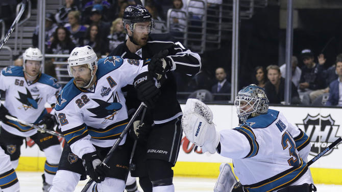 San Jose Sharks goalie Antti Niemi, right, grabs a shot as San Jose Sharks' Dan Boyle (22) and Los Angeles Kings' Dwight King battle in front of the net during the second period in Game 1 of their second-round NHL hockey Stanley Cup playoff series in Los Angeles, Tuesday, May 14, 2013. (AP Photo/Chris Carlson)