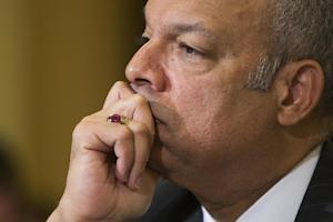 Homeland Security Secretary Jeh Johnson listens on …