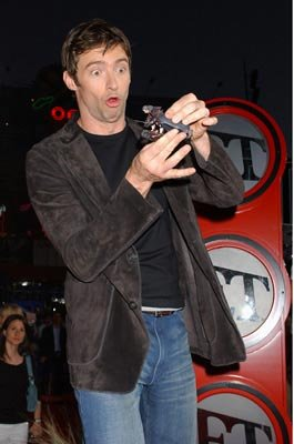 Hugh Jackman plays with the action figures from him movie at the L.A. premiere of Universal Pictures' Van Helsing