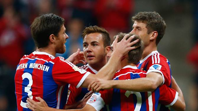 Bayern Munich's Goetze celebrates with team mates after he scored a goal against Paderborn during their German first division Bundesliga soccer match in Munich