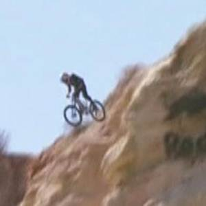 Extreme bikers launch over canyon gap in thrilling race