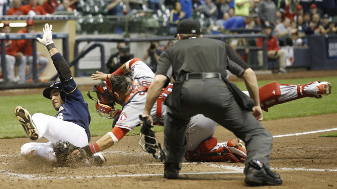 Milwaukee Brewers' Ryan Braun slides safely past Los Angeles Angels catcher Geovany Soto at home during the fifth inning of a baseball game Monday, May 2, 2016, in Milwaukee. Braun scored from first on a double by Jonathan Lucroy. (AP Photo/Morry Gash)