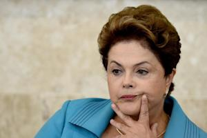 Brazilian President Dilma Rousseff gestures while attending …