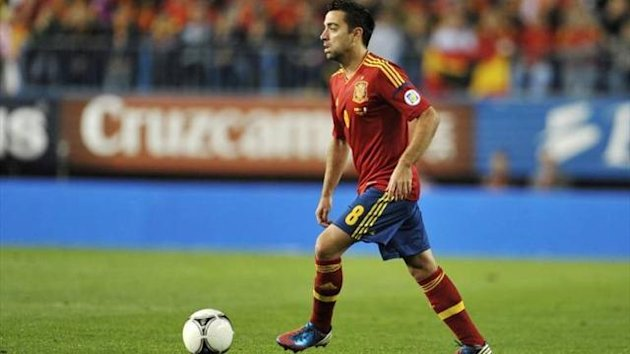 Xavi in action for Spain
