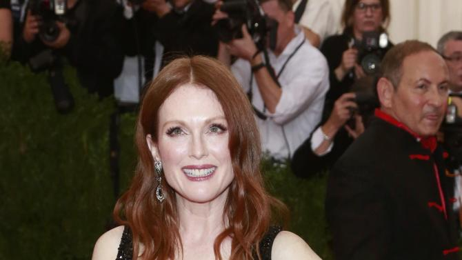 "U.S.-British actress Julianne Moore arrives for the Metropolitan Museum of Art Costume Institute Gala 2015 celebrating the opening of ""China: Through the Looking Glass,"" in Manhattan"