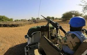 UNAMID peacekeepers patrol the damaged and empty Labado village in South Darfur