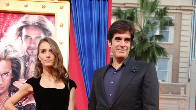 Chloe Gosselin and David Copperfield at New Line Cinema's World Premiere of 'The Incredible Burt Wonderstone' held at Grauman's Chinese Theatre on Monday, Mar., 11, 2013 in Los Angeles. (Photo by Eric Charbonneau/Invision for New Line Cinema/AP Images)