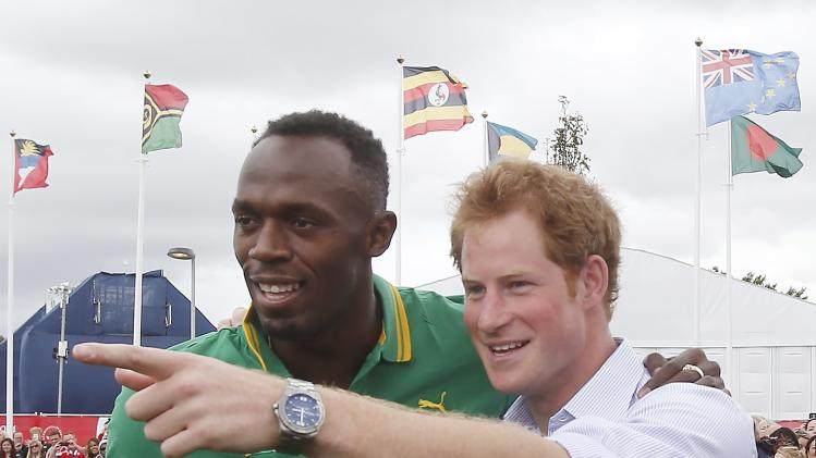 Britain's Prince Harry speaks to Jamaica's Usain Bolt during a visit to the Commonwealth Games Village at the 2014 Commonwealth Games in Glasgow
