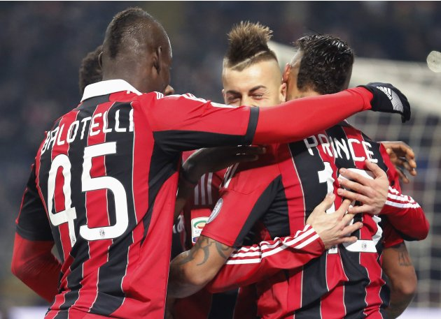 AC Milan's El Shaarawy celebrates with teammates Boateng and Balotelli after scoring against Inter Milan during their Italian Serie A soccer match in Milan