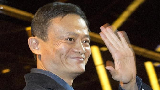 FILE -In this Sept. 15, 2014 file photo, Alibaba Group founder and Executive Chairman Jack Ma waves to reporters before an IPO road show at a hotel in Hong Kong. When Jack Ma founded Alibaba 15 years ago he insisted the e-commerce venture should see itself as competing against Silicon Valley, not other Chinese companies. That bold claim from a time when China was still a corporate backwater has been vindicated by Alibaba completing a mammoth sale of shares to investors in the U.S. and elsewhere. The shares start trading in New York on Friday, Sept. 19, 2014. (AP Photo/Vincent Yu, File)