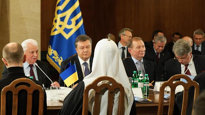Ukraine's political, government, opposition and religious leaders at a round-table meeting, facing from left to right: ex-president Leonid Kravchuk, current president Viktor Yanukpvych, ex-president Leonid Kuchma, ex-president Viktor Yushchenko in Kiev, Ukraine, Friday, Dec. 13, 2013. Ukraine's president proposed an amnesty Friday for all those facing criminal charges in the country's wave of anti-government demonstrations, but the gesture did little to mollify opposition leaders driving the protests. (AP Photo/Maxim Dondyuk)