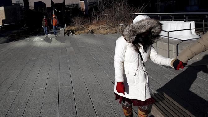 People walk along the High Line in the Manhattan borough of New York.