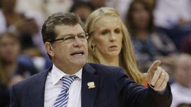 Connecticut head coach Geno Auriemma directs his team in the first half against Notre Dame at a women's NCAA Final Four college basketball tournament semifinal, Sunday, April 7, 2013, in New Orleans. (AP Photo/Dave Martin)