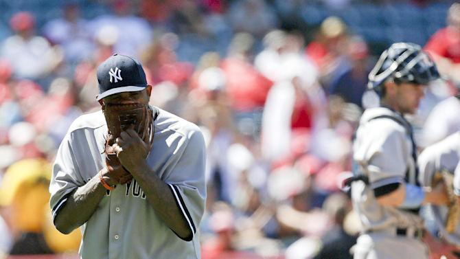 New York Yankees starting pitcher CC Sabathia reacts after being taken out of the game in the bottom of the ninth inning of a baseball game against the Los Angeles Angels in Anaheim, Calif., Sunday, June 16, 2013. (AP Photo/Chris Carlson)