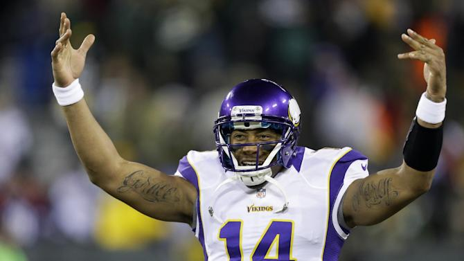 Minnesota Vikings quarterback Joe Webb (14) cheers up his teammates before an NFL wild card playoff football game against the Green Bay Packers Saturday, Jan. 5, 2013, in Green Bay, Wis. (AP Photo/Jeffrey Phelps)