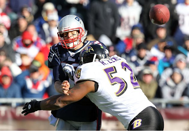 FOXBORO, MA - JANUARY 10: Tom Brady #12 of the New England Patriots is hit as he throws the ball by Ray Lewis #52 of the Baltimore Ravens during the 2010 AFC wild-card playoff game at Gillette Stadium