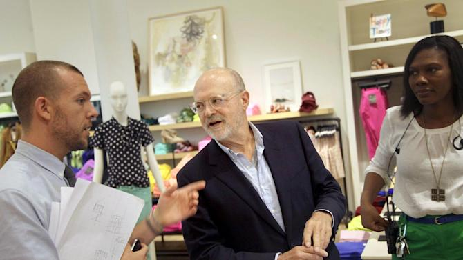 "This Aug. 8, 2012 photo shows J. Crew CEO Millard ""Mickey"" Drexler talking with employees at a J. Crew store in New York. Under his leadership, J. Crew has carved out a place in the fashion hierarchy that's just between trendsetter and accessible, and Drexler seems to like living in that space. (AP Photo/Seth Wenig)"