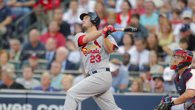 St. Louis Cardinals' David Freese (23) hits a sacrifice fly, bringing in teammate Allen Craig, during the fourth inning of the National League wild card playoff baseball game against the Atlanta Braves, Friday, Oct. 5, 2012, in Atlanta. (AP Photo/Todd Kirkland)