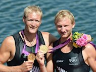 New Zealand's Eric Murray (L) and Hamish Bond celebrate on the podium after receiving their gold medal for the men's pair final of the rowing event during the London 2012 Olympic Games, at Eton Dorney Rowing Centre