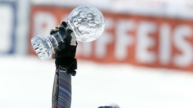 Mikaela Shiffrin from the United States shows of the women's slalom overall standing crystal globe during the Alpine Ski World Cup final in Lenzerheide, Switzerland, Saturday, March 16, 2013. (AP Photo/Alessandro Trovati)