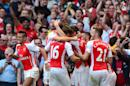 Arsenal players celebrate after teammate Aaron Ramsey scores during their Premier League match against Crystal Palace at The Emirates Stadium on August 16, 2014