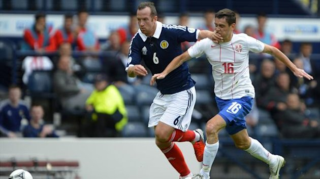 Scotland's Charlie Adam (L) is challenged by Serbia's Srdan Mijailovic during their 2014 World Cup qualifying match at Hampden Park Stadium in Glasgow (Reuters)