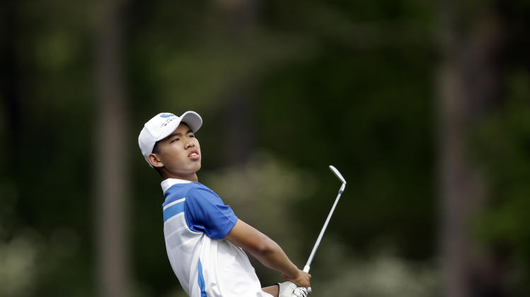 Amateur Guan Tianlang, of China, watches his shot off the 12th fairway during the first round of the Masters golf tournament Thursday, April 11, 2013, in Augusta, Ga. (AP Photo/Matt Slocum)