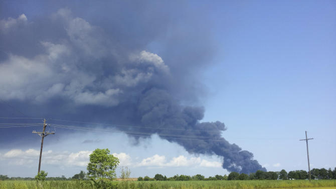 In this photo provided by Mary Clement, a fire burns after an explosion at Multi-Chem Corp. chemical plant in New Iberia, La. Tuesday, June 14, 2011. The fire forced residents to evacuate or hunker down Tuesday evening in their homes. Louisiana state police and Iberia Parish emergency management officials said no one was injured in the initial explosion around 4 p.m. CDT and several blasts that followed.  (AP Photo/Mary Clement)