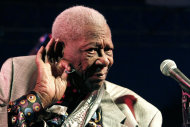 "In this Aug. 22, 2012 photograph, an 86-year-old B.B. King ""listens"" as an audience of several hundred people sing with him at the 32nd annual B.B. King Homecoming, a concert on the grounds of an old cotton gin where he worked as a teenager many years ago, in Indianola, Miss. Now the place_ the B.B. King Museum and Delta Interpretive Center _ is a monument to him and the blues. (AP Photo/Rogelio V. Solis)"
