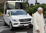 "A handout picture released by the Vatican Press office shows Pope Benedict XVI walking by the new, ecologically-friendly ""popemobile."" On Friday, Mercedes-Benz presented the Pope with the vehicle, which has been vamped up with the latest gadgets for maximum comfort"