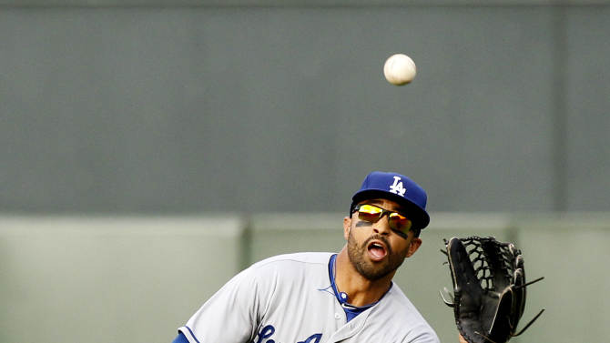 May 5, 2013; San Francisco, CA, USA; Los Angeles Dodgers outfielder Matt Kemp (27) makes a running catch in center against the San Francisco Giants in the fifth inning at AT&T Park. (Cary Edmondson-USA TODAY Sports)