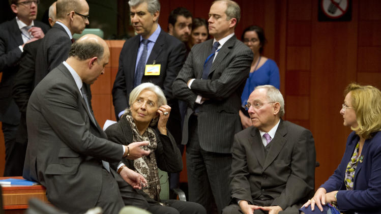 From front left, French Finance Minister Pierre Moscovici, Managing Director of the International Monetary Fund Christine Lagarde, German Finance Minister Wolfgang Schaeuble and Austria's Finance Minister Maria Fekter speak with each other during an emergency eurogroup meeting in Brussels on Sunday, March 24, 2013. The EU says a top official will chair a high-level meeting on Cyprus in a last-ditch effort to seal a deal before finance ministers decide whether the island nation gets a 10 billion euro bailout loan to save it from bankruptcy. (AP Photo/Geert Vanden Wijngaert)